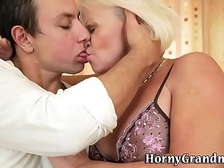 Blonde granny rides and gobbles dick