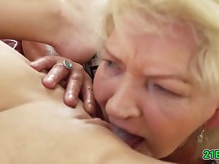 Teen beauty getting eaten out by a GILF