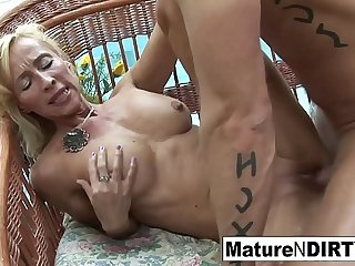 Blonde granny takes a dick by the pool