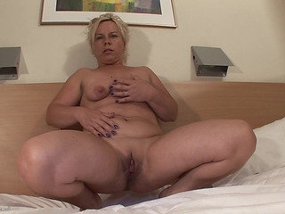 Older striptease in a hotel room ends in sexy masturbation