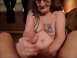 Granny with Glasses Giving a Nice Handjob